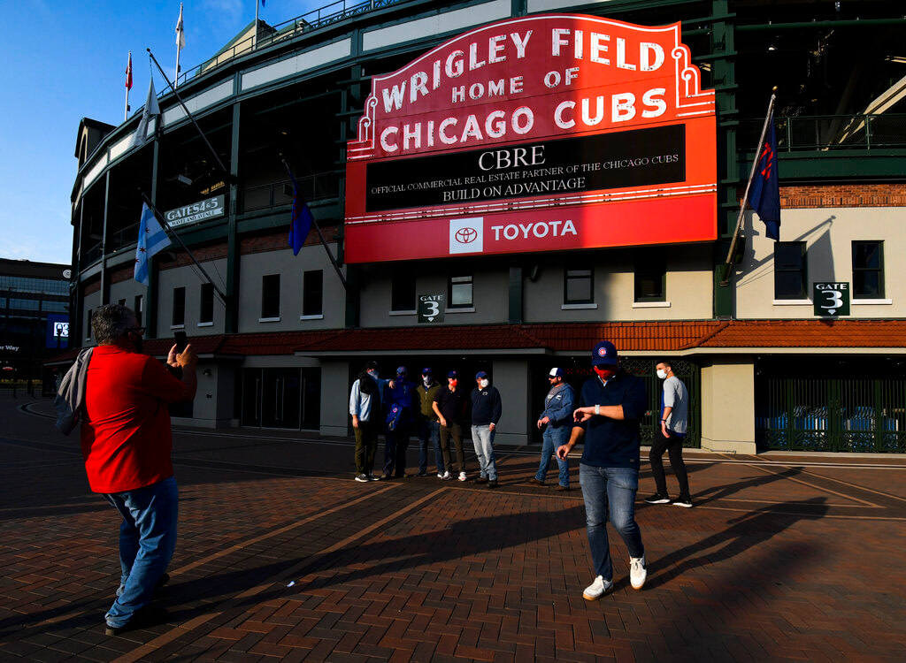Fans are reacting to news that Chicago will allow fans at baseball games by April
