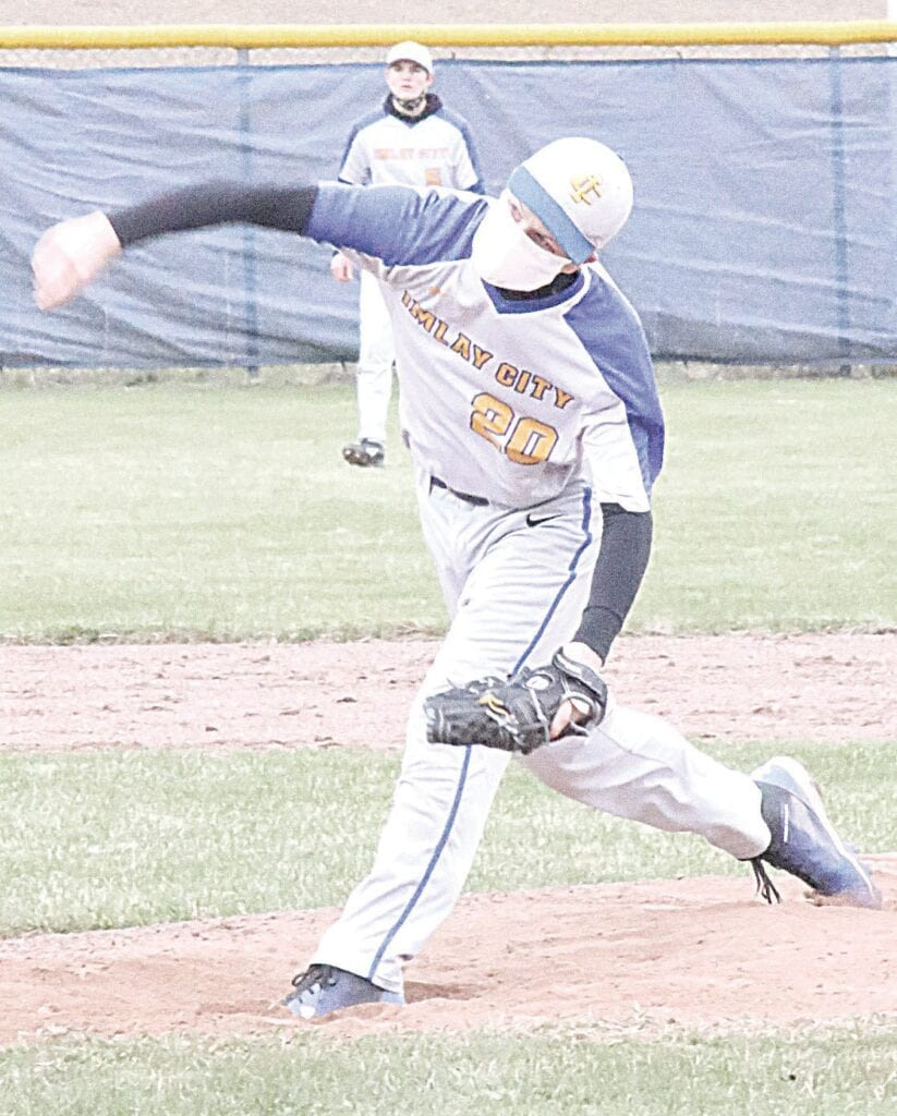 Imlay City's Cole Schwab launches a pitch towards home plate during Thursday's game against Brown City. Photo by Kylee Richardson