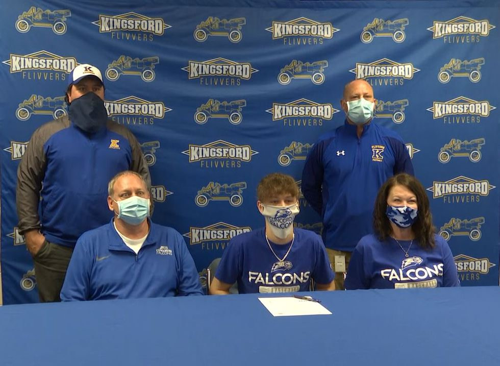 Kingsford Senior, Andrew Paupore, signs to play college baseball at Concordia University