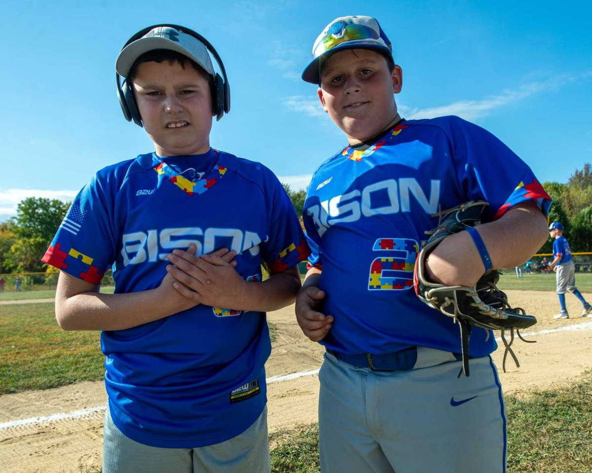 Thirteen-year-old Carter Durant, who has autism, with his brother 10-year-old Griffin Durant, a player on the North Colonie Bison 11U team, wear jerseys with colored puzzle pieces, the symbol for autism, fashioning the numbers and trim prior to a game against Guilderland at the Boght Road Baseball Complex in Colonie, NY, on Saturday, Sept. 26, 2020 (Jim Franco/special to the Times Union.)