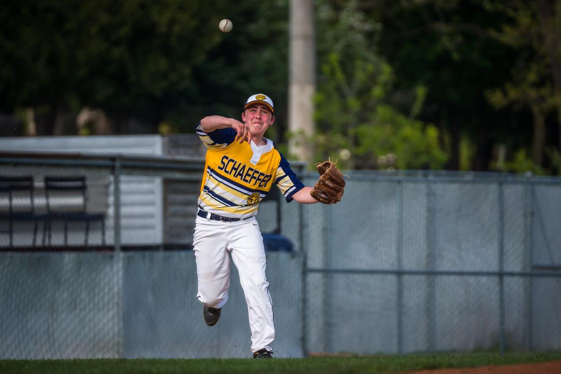 Schaeffer Academy third baseman Jarrett Minot (1) throws to first base for one out after dropping a ground ball during a baseball game against Southland on Monday 17 May 2021 at Mayo Field in Rochester.  (Joe Ahlquist / jahlquist@postbulletin.com)