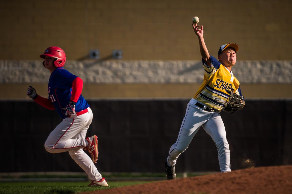 Schaeffer Academy second baseman Minsoo Choung (21) throws home after hitting a ground ball during a baseball game against Southland on Monday 17 May 2021 at Mayo Field in Rochester.  (Joe Ahlquist / jahlquist@postbulletin.com)
