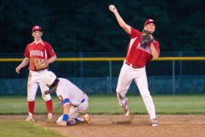 A player from the Hudson Legion Post 100 makes a hard throw from second base during the team's match against Ashland.