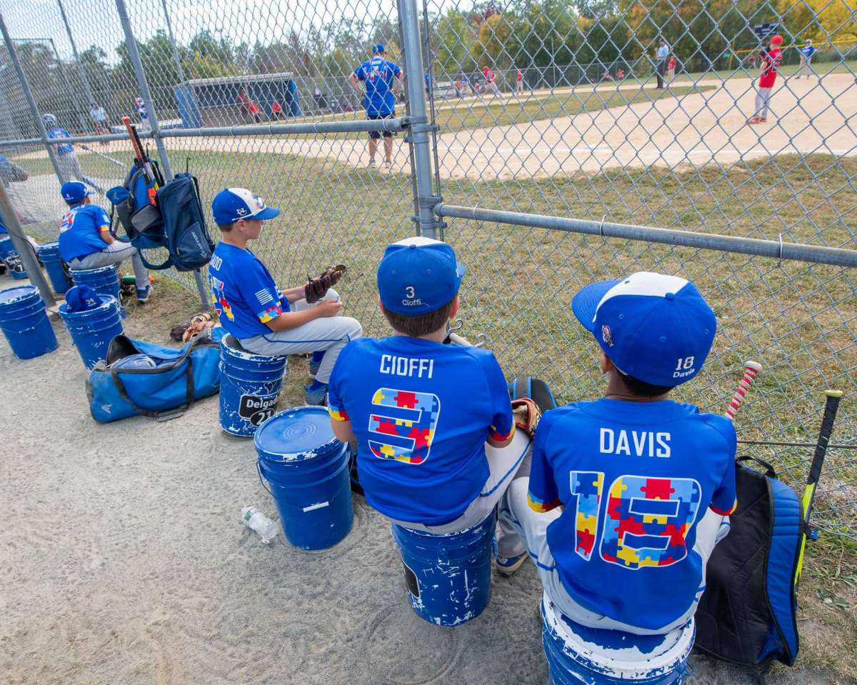 Players on the North Colonie Bison 11U team, all sporting jerseys with colored puzzle pieces, the symbol for autism, fashioning their numbers and trim, sit along the sideline during a game against Guilderland at the Boght Road Baseball complex in Colonie, NY, on Saturday, Sept. 26, 2020. (Jim Franco/special to the Times Union.)