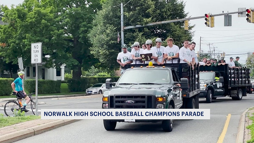 The parade honors the Norwalk High School baseball team's first state championship