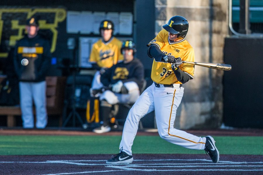 Iowa + outfielder + Trenton + Wallace + swings + while + on-bat + during + the + second + game + of + a + baseball + double header + between + Iowa + and + Cal-State + Northridge + at + Duane + Banks + Field + on + Sunday% 2C + March + 17% 2C + 2019. +