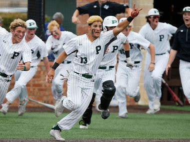 Gabriel Colina (13) leads his team that sprints out of the excavation after completing a come-back victory in its final battle, when Prosper High School hosted Arlington Martin High School in a league competition 6A Region I playoff game Saturday afternoon, May 15, 2021.