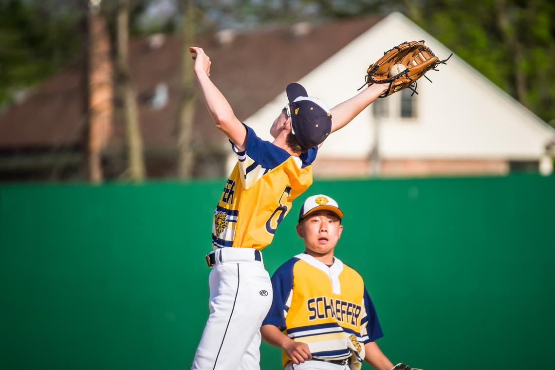 Schaeffer Academy's Owen Larson (6) catches a flyball during a baseball game against Southland on Monday, May 17, 2021 at Mayo Field in Rochester.  (Joe Ahlquist / jahlquist@postbulletin.com)