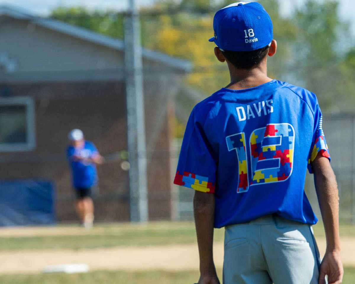 Damari Davis, a player on the North Colonie Bison 11U team, sports jerseys with colored puzzle pieces, the symbol for autism, fashioning his number adn trim, during warmups prior to a game against Guilderland at the Boght Road Baseball complex in Colonie, NY, on Saturday, Sept. 26, 2020. (Jim Franco/special to the Times Union.)
